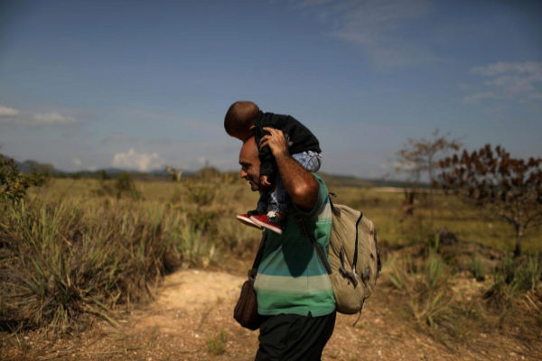 FILE PHOTO: A <HIT>Venezuelan</HIT> <HIT>migrant</HIT> carrying a baby...