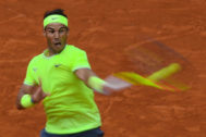 Spain's Rafael <HIT>Nadal</HIT> returns the ball to Austria's Dominic Thiem during their men's singles final match, on day fifteen of The Roland Garros 2019 French Open tennis tournament in Paris on June 9, 2019. (Photo by CHRISTOPHE ARCHAMBAULT / AFP)
