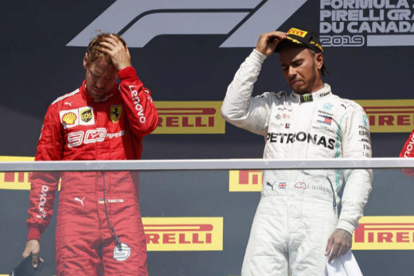 VXH20. Montreal (Canada).- British Formula One driver Lewis <HIT>Hamilton</HIT> of Mercedes AMG GP (R) and German Formula One driver Sebastian <HIT>Vettel</HIT> of Scuderia Ferrari (L) react on the podium after the 2019 Canada Formula One Grand Prix at the Gilles Villeneuve circuit in Montreal, Canada, 09 June 2019. <HIT>Hamilton</HIT> won the 2019 Canada Formula One Grand Prix after <HIT>Vettel</HIT> was given a five second penalty leaving him in second place. (Fórmula Uno) EPA/