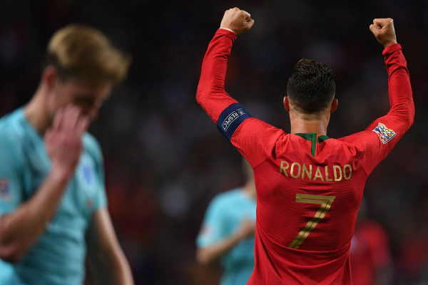 <HIT>Portugal</HIT>'s forward Cristiano Ronaldo celebrates his team's victory at the end of the UEFA Nations League final football match between <HIT>Portugal</HIT> and The Netherlands at the Dragao Stadium in Porto on June 9, 2019. (Photo by PATRICIA DE MELO MOREIRA / AFP)