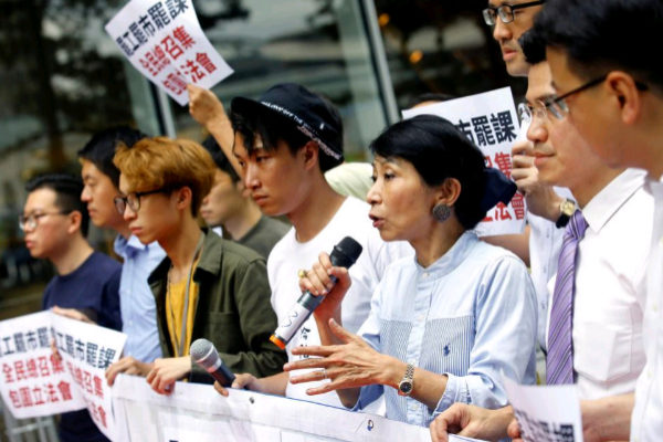 Pro-democracy legislator Claudia Mo speaks during a protest outside the Legislative Council building in <HIT>Hong</HIT> <HIT>Kong</HIT>