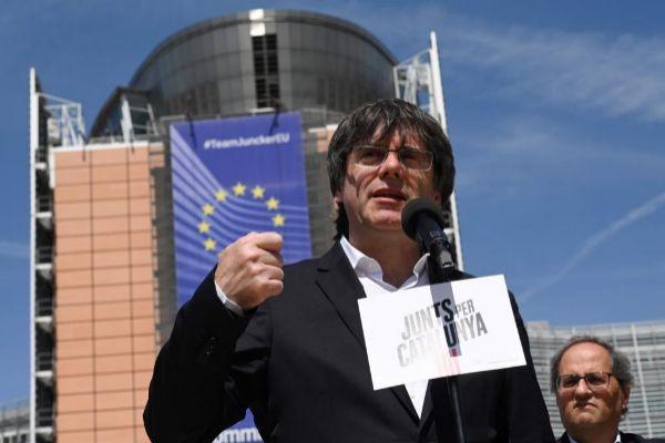Carles Puigdemont y Quim Torra, durante un acto en Bruselas esta semana