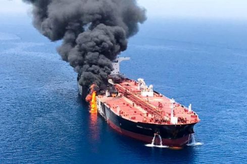 An oil tanker is seen after it was attacked at the Gulf of <HIT>Oman</HIT>