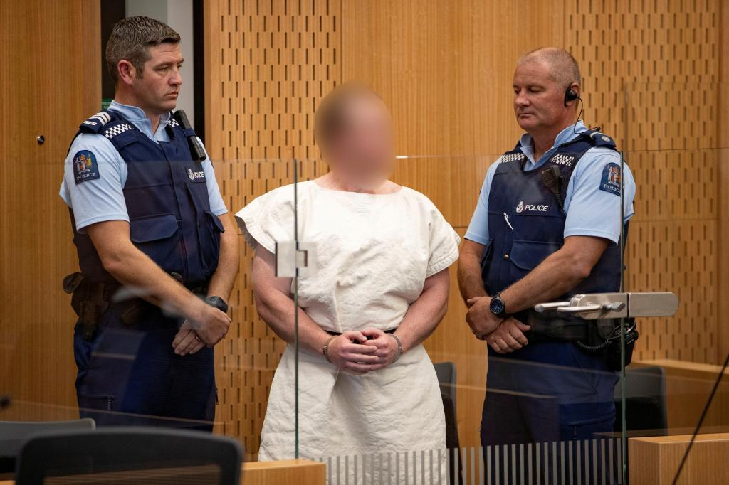 FILE PHOTO: Brenton <HIT>Tarrant</HIT>, charged for murder in relation to the mosque attacks, is seen in the dock during his appearance in the Christchurch District Court