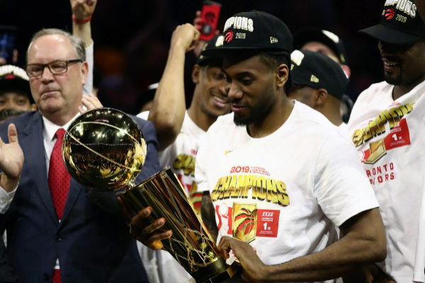 == FOR NEWSPAPERS, INTERNET, TELCOS & TELEVISION USE ONLY == OAKLAND, CALIFORNIA - JUNE 13: <HIT>Kawhi</HIT> <HIT>Leonard</HIT> #2 of the Toronto Raptors celebrates with the Larry O'Brien Championship Trophy after his team defeated the Golden State Warriors to win Game Six of the 2019 NBA Finals at ORACLE Arena on June 13, 2019 in Oakland, California. NOTE TO USER: User expressly acknowledges and agrees that, by downloading and or using this photograph, User is consenting to the terms and conditions of the Getty Images License Agreement. Ezra Shaw/Getty Images/AFP