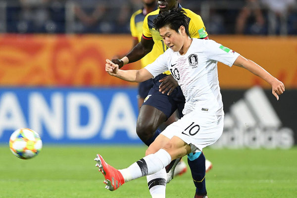 South Korea&amp;apos;s <HIT>Lee</HIT> <HIT>Kang</HIT>-in vies for the ball with...