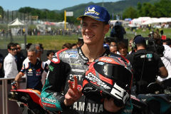 Scarperia (Italy).- French Moto GP rider Fabio <HIT>Quartararo</HIT> (C) of Petronas Yamaha SRT celebrates getting the second position on the grid after the qualifying session of the Motorcycling Grand Prix of Italy at the Mugello circuit in Scarperia, central Italy, 01 June 2019. (Motociclismo, Ciclismo, Italia) EPA/