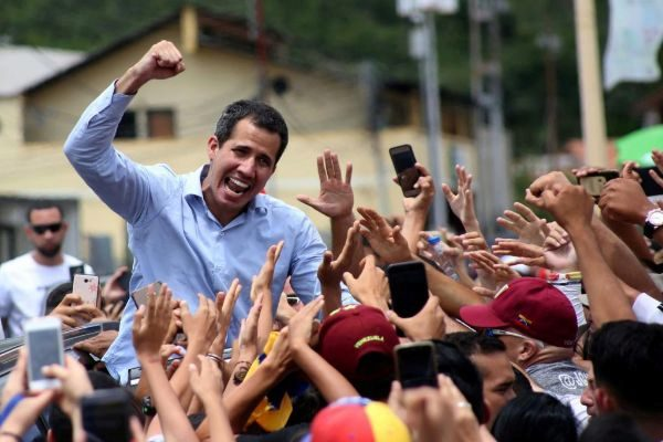 Venezuelan opposition leader <HIT>Juan</HIT> <HIT>Guaido</HIT>, who many nations have recognised as the country's rightful interim ruler, greets supporters after delivering a speech in Tovar