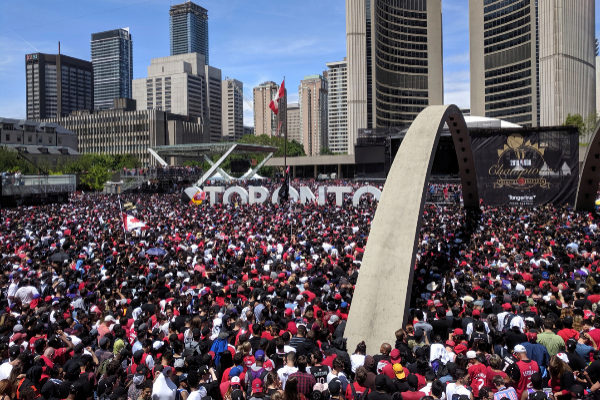 <HIT>Toronto</HIT> fans gather in front of the city hall during the <HIT>Toronto</HIT> Raptors NBA Championship celebration parade at Nathan Phillips Square in <HIT>Toronto</HIT>