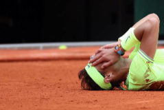 Paris (France).- Rafael <HIT>Nadal</HIT> of Spain reacts after winning the men'Äôs final match against Dominic Thiem of Austria during the French Open tennis tournament at Roland Garros in Paris, France, 09 June 2019. <HIT>Nadal</HIT> won the French Open title 12th times. (Tenis, Abierto, Abierto, Francia, España) EPA/