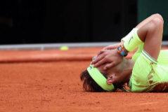 Paris (France).- Rafael <HIT>Nadal</HIT> of Spain reacts after winning the men'Äôs final match against Dominic Thiem of Austria during the French Open tennis tournament at Roland Garros in Paris, France, 09 June 2019. <HIT>Nadal</HIT> won the French Open title 12th times. (Tenis, Abierto, Abierto, Francia, España) EPA/