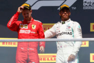 VXH49. Montreal (Canada).- British Formula One driver Lewis Hamilton of Mercedes AMG GP (R) and German Formula One driver Sebastian <HIT>Vettel</HIT> of Scuderia Ferrari (L) react on the podium after the 2019 Canada Formula One Grand Prix at the Gilles Villeneuve circuit in Montreal, Canada, 09 June 2019. Hamilton won the 2019 Canada Formula One Grand Prix after <HIT>Vettel</HIT> was given a five second penalty leaving him in second place. (Fórmula Uno) EPA/
