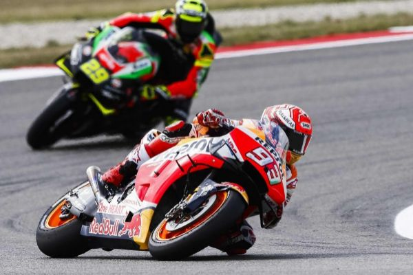 Repsol Honda's Spanish rider Marc <HIT>Marquez</HIT> rides in front of Aprilia RS-GP's Italian rider Andrea Iannone (ITA) during the free practice of the MotoGP on the TT circuit in Assen, the Netherlands, on June 28, 2019. (Photo by Vincent Jannink / ANP / AFP) / Netherlands OUT