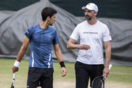 53231989. London (United Kingdom).- Novak Djokovic of Serbia, left, talks to Goran <HIT>Ivanisevic</HIT> during a training session at the All England Lawn Tennis Championships in Wimbledon, London, on Sunday, June 30, 2019. (Tenis, Reino Unido, Londres) EPA/ EDITORIAL USE ONLY; NO SALES, NO ARCHIVES