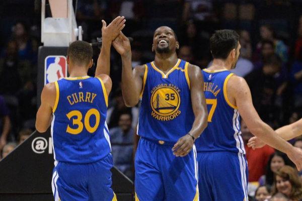 Durant y Curry, durante un partido con Golden State.