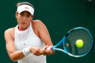Spain's Garbine <HIT>Muguruza</HIT> returns the ball to Brazil's Beatriz Haddad Maia during their women's singles first round match on the second day of the 2019 Wimbledon Championships at The All England Lawn Tennis Club in Wimbledon, southwest London, on July 2, 2019. (Photo by Adrian DENNIS / AFP) / RESTRICTED TO EDITORIAL USE
