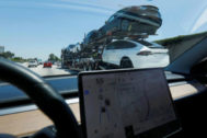 Newly built <HIT>Tesla</HIT> electric vehicles are transported for delivery along a highway in Los Angeles, California