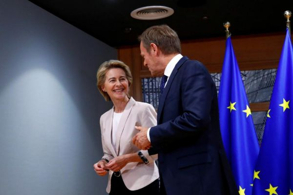 German Defense Minister von der Leyen poses with EU Council President <HIT>Tusk</HIT> in Brussels