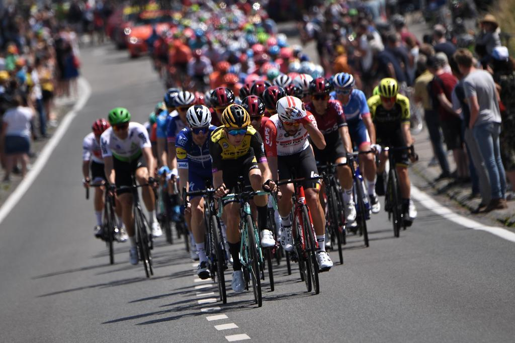 The pack rides in the first stage of the 106th edition of the <HIT>Tour</HIT> de <HIT>France</HIT> cycling race between Brussels and Brussels, Belgium, on July 6, 2019. (Photo by Marco Bertorello / AFP)