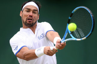LONDON, ENGLAND - JULY 06: Fabio <HIT>Fognini</HIT> of Italy plays a backhand in his Men's Singles third round match against Tennys Sandgren of The United States during Day six of The Championships - Wimbledon 2019 at All England Lawn Tennis and Croquet Club on July 06, 2019 in London, England. (Photo by Laurence Griffiths/Getty Images)