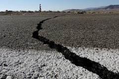 Fissures that opened up under a highway during a powerful earthquake that struck Southern <HIT>California</HIT> are seen near the city of Ridgecrest