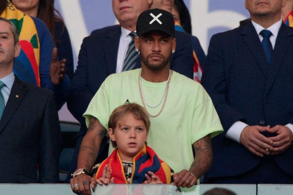 Brazilian injured footballer <HIT>Neymar</HIT> and his son are seen on...