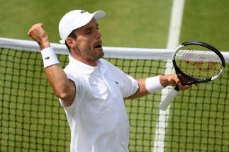 LONDON, ENGLAND - JULY 08: Roberto <HIT>Bautista</HIT> Agut of Spain celebrates match point in his Men's Singles fourth round match against Benoit Paire of France during Day Seven of The Championships - Wimbledon 2019 at All England Lawn Tennis and Croquet Club on July 08, 2019 in London, England. (Photo by Mike Hewitt/Getty Images)