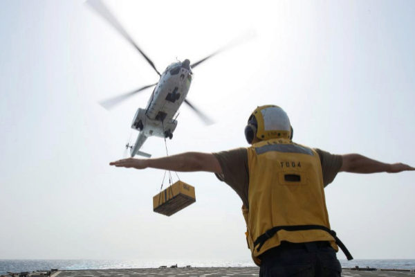 A <HIT>U.S</HIT>. Navy sailor directs an SA-330J Puma Helicopter attached to <HIT>Military</HIT> Sealift Command dry cargo and ammunition ship USNS Cesar Chavez on the flight deck of amphibious dock landing ship USS Harpers Ferry in the Gulf of Aden