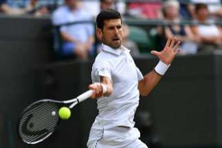 Serbia's Novak <HIT>Djokovic</HIT> returns against France's Ugo Humbert during their men's singles fourth round match on the seventh day of the 2019 Wimbledon Championships at The All England Lawn Tennis Club in Wimbledon, southwest London, on July 8, 2019. (Photo by GLYN KIRK / AFP) / RESTRICTED TO EDITORIAL USE