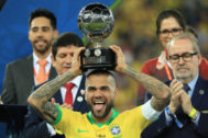 RIO DE JANEIRO, BRAZIL - JULY 07: <HIT>Dani</HIT> <HIT>Alves</HIT> of Brazil poses with the trophy of Best Player of the tournament after winning the Copa America Brazil 2019 Final match between Brazil and Peru at Maracana Stadium on July 07, 2019 in Rio de Janeiro, Brazil. (Photo by Buda Mendes/Getty Images)