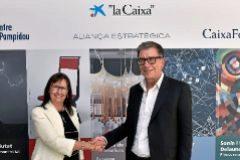 Elisa Durán y Serge Lasvignes posan tras firmar el acuerdo.