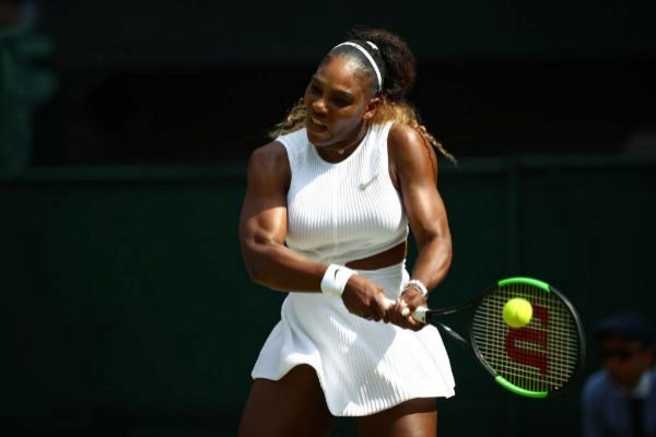 US player <HIT>Serena</HIT> <HIT>Williams</HIT> returns against Czech Republic's Barbora Strycova during their women's singles semi-final match on day ten of the 2019 Wimbledon Championships at The All England Lawn Tennis Club in Wimbledon, southwest London, on July 11, 2019. (Photo by HANNAH MCKAY / POOL / AFP) / RESTRICTED TO EDITORIAL USE