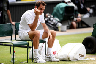 LONDON, ENGLAND - JULY 14: Roger <HIT>Federer</HIT> of Switzerland reacts following defeat in his Men's Singles final against Novak Djokovic of Serbia during Day thirteen of The Championships - Wimbledon 2019 at All England Lawn Tennis and Croquet Club on July 14, 2019 in London, England. (Photo by Matthias Hangst/Getty Images)