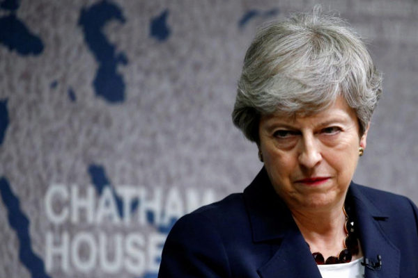 Britain&apos;s Prime Minister <HIT>Theresa</HIT> <HIT>May</HIT> delivers a...
