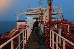 An Iranian Revolutionary Guard member walks onboard of Stena Impero, a British-flagged vessel owned by Stena Bulk, in Bandar Abbas port