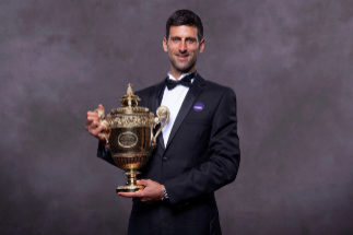 A handout picture released by the All England Lawn Tennis and Croquet Club on July 15, 2019, shows 2019 Wimbledon Men's singles champion Serbia's Novak <HIT>Djokovic</HIT> posing for a photograph with his trophy at the Champions Dinner on July 14, 2019 in central London. (Photo by Thomas LOVELOCK / AELTC / AFP)