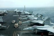 F/A-18F aircrafts are seen on the deck of USS Abraham Lincoln in the <HIT>Gulf</HIT> of Oman near the Strait of Hormuz