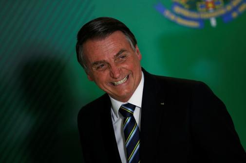 Brazil&apos;s President Jair <HIT>Bolsonaro</HIT> attends the ceremony...