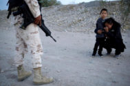 Guatemalan migrant <HIT>Ledy</HIT> <HIT>Perez</HIT> embraces her son Anthony while praying to ask a member of the Mexican National Guard to let them cross into the United States, as seen from Ciudad Juarez