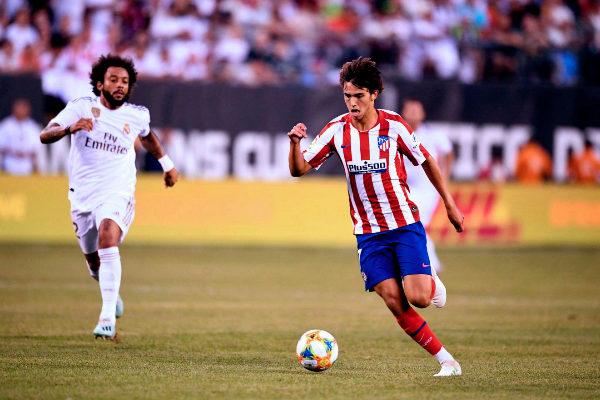 Real Madrid's Brazilian defender Marcelo (L) runs after Atletico...
