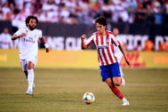 Real Madrid's Brazilian defender Marcelo (L) runs after Atletico Madrid's Portuguese midfielder <HIT>Joao</HIT> <HIT>Felix</HIT> as he controls the ball during their 2019 International Champions Cup football match between Real Madrid and Atletico Madrid at the Metlife Stadium Arena in East Rutherford, New Jersey on July 26, 2019. (Photo by Johannes EISELE / AFP)
