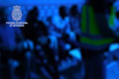 Fotograma de un vídeo de la operación, con los detenidos en primer término.