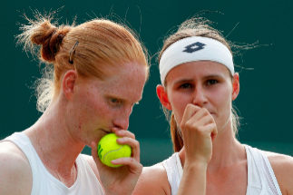 (FILES) In this file photo taken on July 5, 2019 Belgium's Greet Minnen (R) and Belgium's Alison talk as they play Taiwan's Chan Hao-ching and Taiwan's Latisha Chan during their women's doubles second round match on the fifth day of the 2019 Wimbledon Championships at The All England Lawn Tennis Club in Wimbledon, southwest London. - When Alison Van Uytvanck took on fellow Belgian Greet Minnen in the WTA tournament in <HIT>Karlsruhe</HIT> on July 29, 2019 there was more to the match than a place in the second round. Van Uytvanck and Minnen, two of the few openly gay players on the tour, are partners off the court as well as on it; they played doubles together at Wimbledon earlier this month. But before Monday's first-round encounter in Germany, they had never faced each other in a singles match on tour. (Photo by Adrian DENNIS / AFP) / RESTRICTED TO EDITORIAL USE