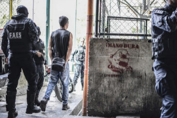 *** NO VOLVER A UTILIZAR - NUEVA COMPRA NECESARIA*** PETARE, CARACAS, VENEZUELA - 2019/01/25: A member of a criminal group seen being arrested by the Bolivarian National Police Special Forces (FAES in Spanish) during a Police raid operation against criminal groups at Petare slum in Caracas. (Photo by Roman <HIT>Camacho</HIT>/SOPA Images/LightRocket via Getty Images)