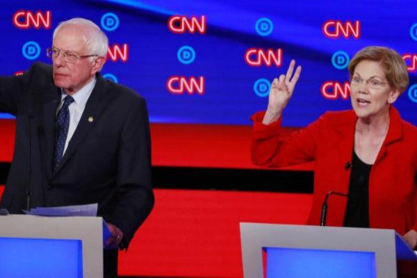 U.S. Senators <HIT>Sanders</HIT> and <HIT>Warren</HIT> speak on the...