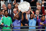 Manchester <HIT>City</HIT>'s Argentinian striker Sergio Aguero (CL) and Manchester <HIT>City</HIT>'s Spanish midfielder David Silva (CR) raise the trophy after winning the English FA Community Shield football match between Manchester <HIT>City</HIT> and Liverpool at Wembley Stadium in north London on August 4, 2019. (Photo by Adrian DENNIS / AFP) / NOT FOR MARKETING OR ADVERTISING USE / RESTRICTED TO EDITORIAL USE