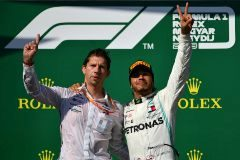 BUDAPEST, HUNGARY - AUGUST 04: Race winner Lewis Hamilton of Great Britain and <HIT>Mercedes</HIT> GP celebrates on the podium with <HIT>Mercedes</HIT> GP Chief Strategist James Vowles during the F1 Grand Prix of Hungary at Hungaroring on August 04, 2019 in Budapest, Hungary. (Photo by Dan Mullan/Getty Images)