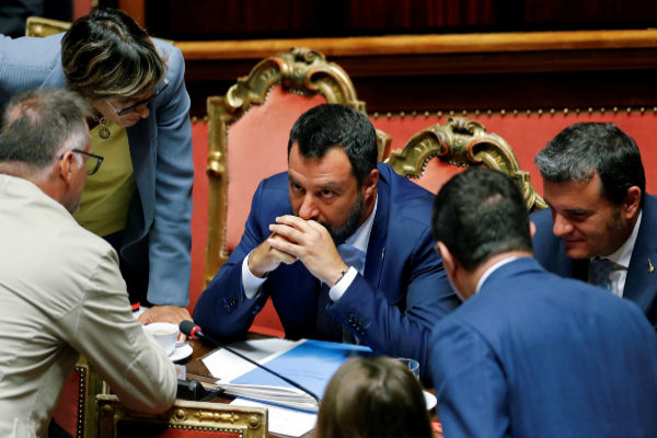 Italy&amp;apos;s Interior Minister <HIT>Salvini</HIT> leaves listens after the...