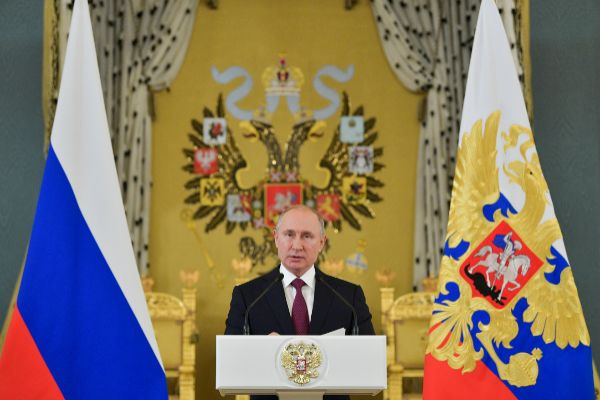 Russian President Vladimir <HIT>Putin</HIT> delivers a speech during a...