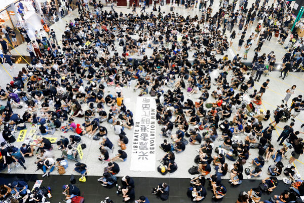 Anti-extradition bill demonstrators attend a protest at the arrival...